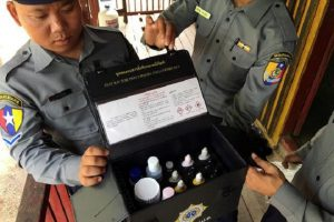 """Police in Myanmar's Tamu district show a test kit used to identify pseudoephedrine in Myanmar's Chin State, near the border with India where huge quantities of Indian-made pseudoephedrine, the main ingredient for the highly addictive drug methamphetamine, or """"meth,"""" is smuggled over the border into Myanmar May 11, 2016. Picture taken May 11, 2016. REUTERS/Andrew RC Marshall"""