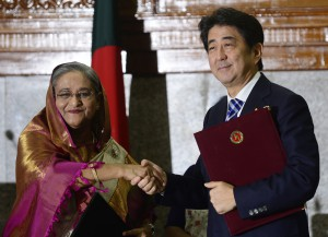 Japanese Prime Minister Shinzo Abe (R) and Bangladesh Prime Minister Sheikh Hasina (L) pose for a photo after a signing ceremony at the Prime Minister's office in Dhaka on September 6, 2014. Japanese premier Shinzo Abe secured Dhaka's support for Tokyo's bid for a non-permanent seat in the UN Security Council as he started a three-day visit to Bangladesh and Sri Lanka aimed at offsetting China's mounting influence in South Asia. AFP PHOTO/ Munir uz ZAMAN (Photo credit should read MUNIR UZ ZAMAN/AFP/Getty Images)